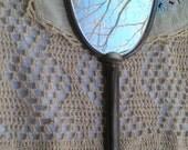 Antique handheld mirror