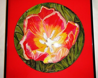 """Hand painted silk 10"""" round circle.One of kind Red tulip with dark green leaves. Size of frame is 12""""x12""""."""