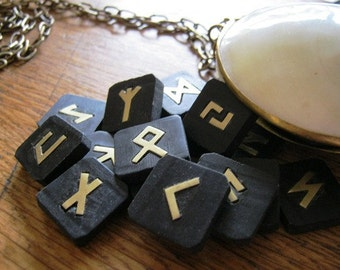 Rune Set. Stone runes. Black serpentine Elder Futhark  runes with brass symbols