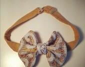 Adjustable unisex pre-tied bow tie