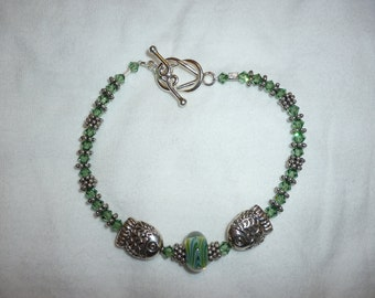 Green Swarovski Bracelet with Lampwork Bead and Sterling Silver Fish