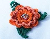 Crocheted, beaded Irish Rose Brooch in Orange (custom order for Jennifer)