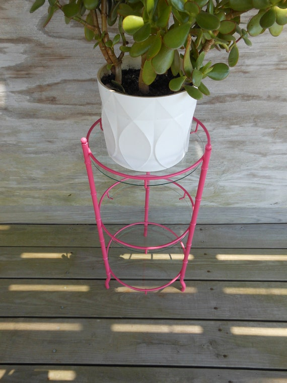 metal side table / hot pink faux bamboo plant stand. / 3 leg glass table