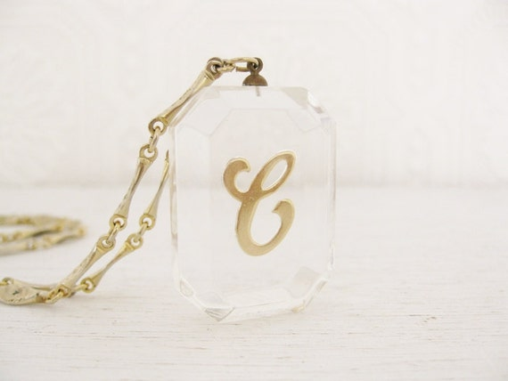 Reserved for Erica. vintage initial letter e necklace. clear lucite. AN UNDERSTATED STATEMENT.