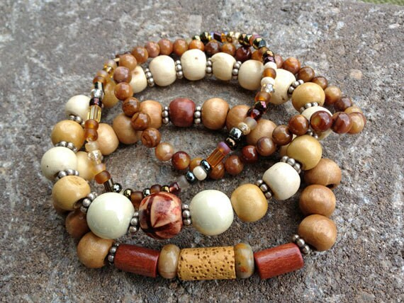 Beaded stretch bracelet set featuring 6mm Tiger's Eye beads, amber Czech beads, and various wooden beads.