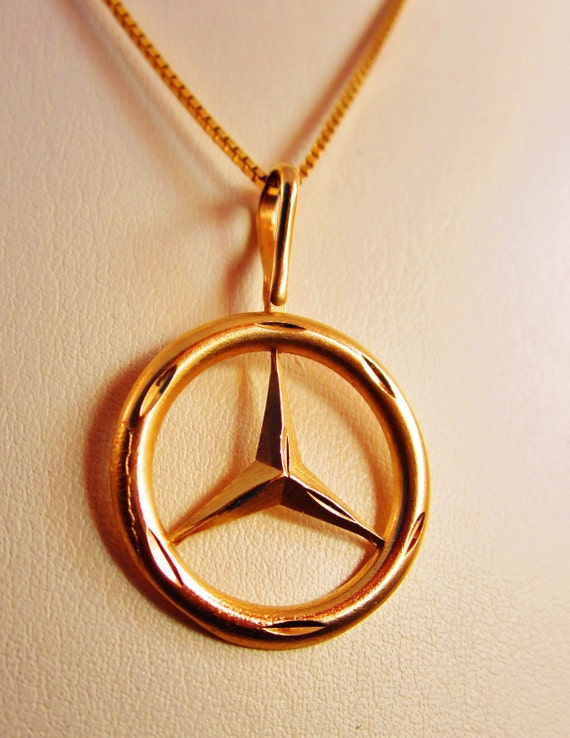 Unavailable listing on etsy for Mercedes benz pendant