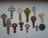 Vintage set of 12 keys different sizes, colors  and styles  2oz.  Scrap metal For Art or Craft projects  Steampunk