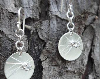 Single Starburst Silver Earrings