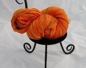 """Hand dyed yarn: """"Fela--Another Girl on Fire"""", fingering weight, merino wool/cashmere/nylon, 100g/350m/383 yds"""