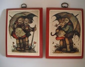 Vintage Hummel Print Boy and Girl Under Umbrella in the Rain Red Wood Plaque