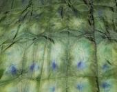 Emerald green tie dye silk scarf with blue patterns
