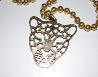 Gold necklace with gold chain and gold leopard pendant