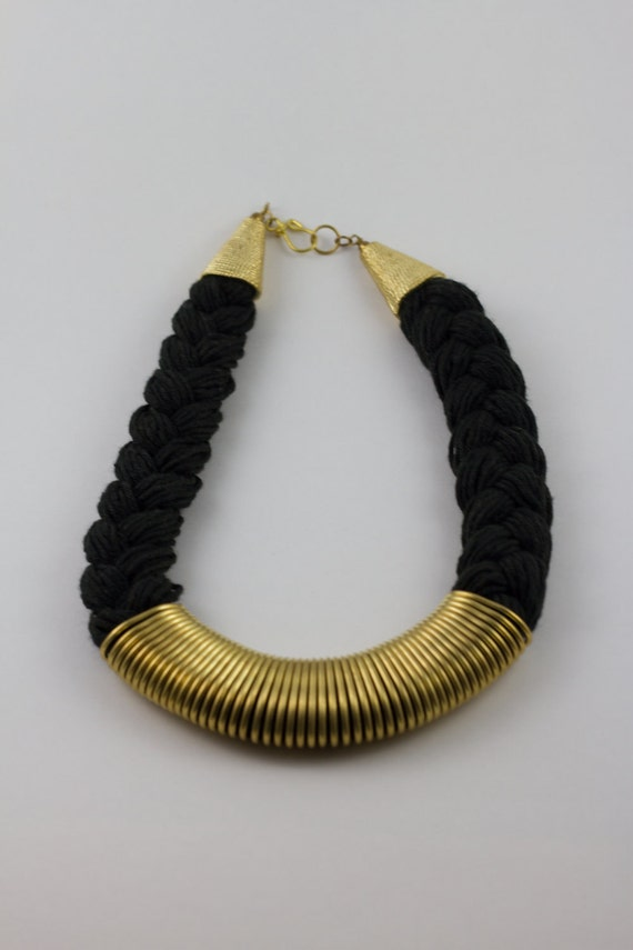 Black thread and gold wire necklace.