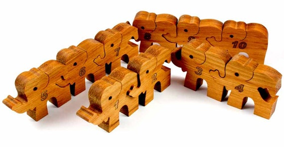 Natural Wooden toy. 10 happy Elephants