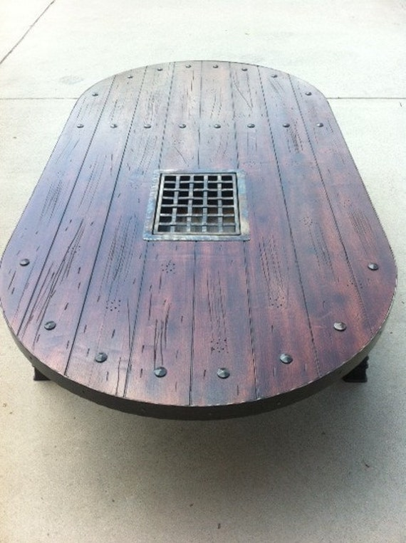 Rustic arched door converted to one of a kind coffee table