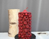 Old, unused candle with fruity decor