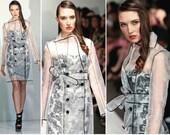 Irina Shabayeva signature sheer mesh trench coat with black satin piping worn by FERGIE