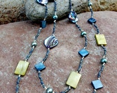 Long summer necklace with blue shells