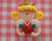 Princess sleeping beauty holding a pink rose/polymer clay/charm/bead/bow center