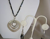 Metallic beaded necklace with brushed silver pendant