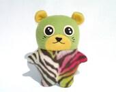 Plush hamster toy kawaii cutie, with bright zebra print and green fleece