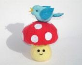 Stuffed kawaii mushroom toy with blue bird friend, red and white polka dots
