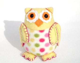 Plushie owl toy with yellow dots and embroidered wings, fun summer colors and polka dots