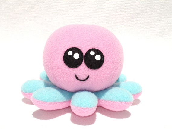 Stuffed octopus baby toy made with pink and turquoise fleece