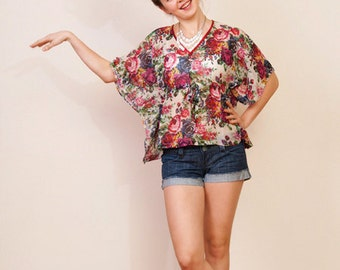Last one. THE FLOWER GIRL Chiffon kaftan crop poncho top in floral print and empire waist. Great gift for her.