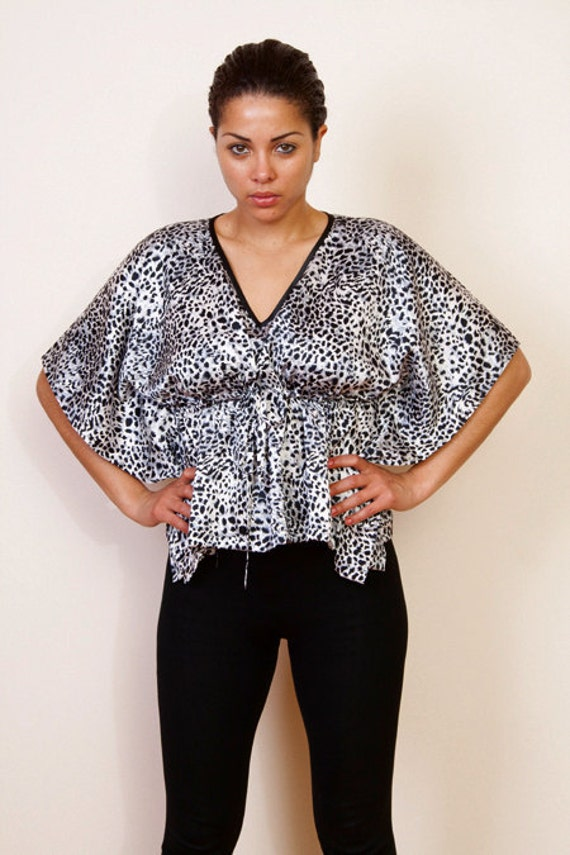 Limited edition. CHANGING SPOTS Satin kaftan poncho cropped top in an animal print and empire waist. Great gift for her.