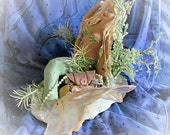 Sculpture Mermaid Guarding Her Treasure