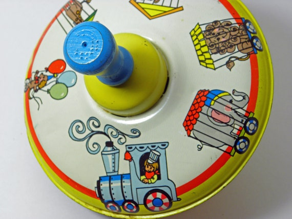 Vintage Childrens Tin toy Circus theme Spinning top from the 1960s collectiable