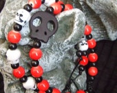 Unisex Beaded red and black bracelet set with black skull bead