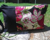 pink black and green floral clutch