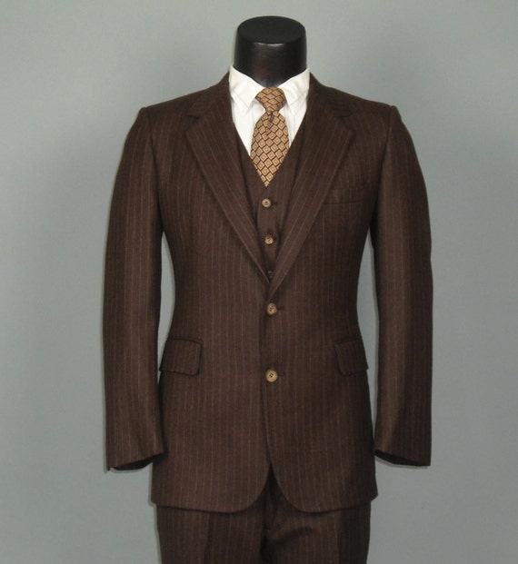 Shopping for Suits With Brown Stripes/Pinstripe Suits for Men Suits that feature stripes can give any man a lot of flair. If you're looking for a dependable and trusted online retailer that can manage all of your mens pinstripe suit requirements, you can take it easy.