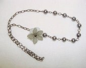Sideflower - gray pearl beaded necklace with flower on the side