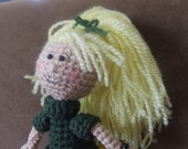 Amigurumi blonde doll with detailed costume and a cute face