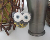 amigurumi little owl with blue eyes for decoration or tree ornament