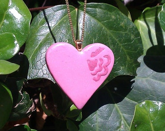 Heart at Your Throat - dusk pink heart-shaped polymer clay pendant with dark pink inlay design and gold bail