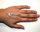 One of a kind silver, slave bracelet, hand piece, ring bracelet combination with centered vintage piece studded with rhinestones