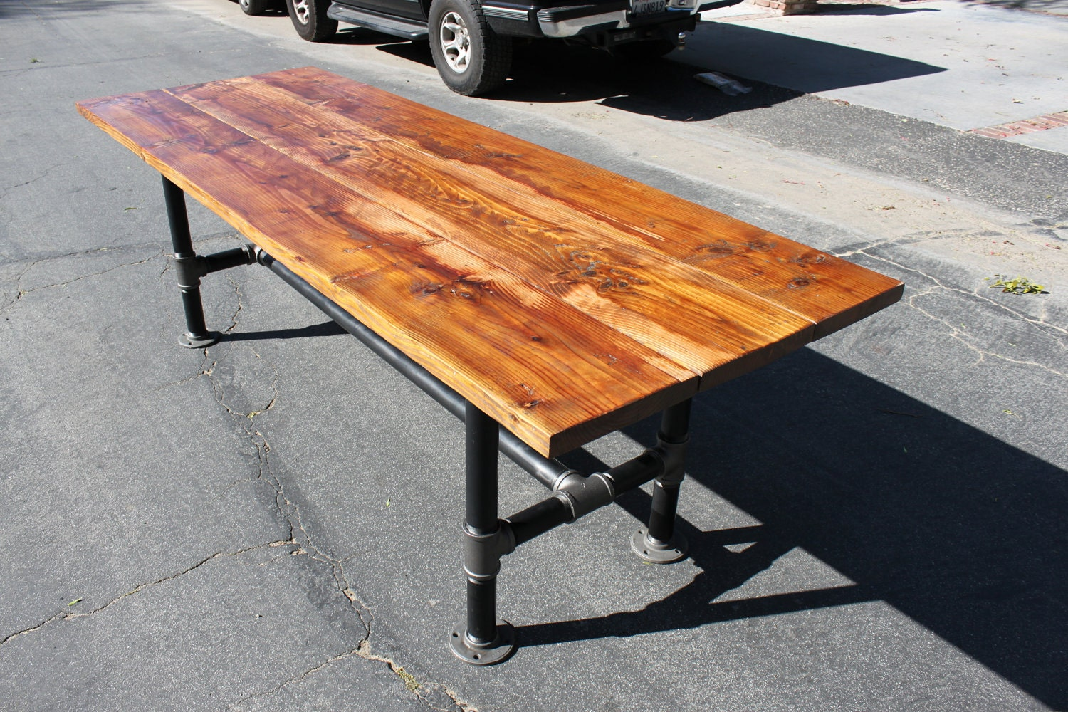 These 6 Pieces Of Colorful Furniture Are Absolute Must Haves: Rustic Reclaimed Wood Table With Industrial Pipe Legs