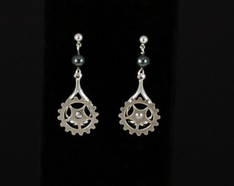 """Steampunk moving """"Gearrings"""" in silver plated brass and antiqued silver plated brass with hematite accents by Sylvan Creations."""