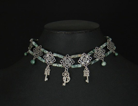 Elegant steampunk choker in tree agate with pewter keys and lock and silver plated filigree by Sylvan Creations.