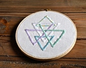 Embroidered pastel triangles