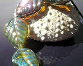 Reserved for VickiB-Handmade bright metallic green leaf lampwork bead sets