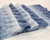 Beautiful blue and white gradient knitted long shawl. Openwork pattern.