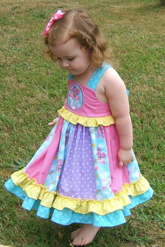 Abby Cadabby Girls Appliqued Ruffle Bow Dress. Abby Cadabby Dress. Sesame Street Dress. Abby Cadabby Birthday. Sesame Street Fairy Dress.