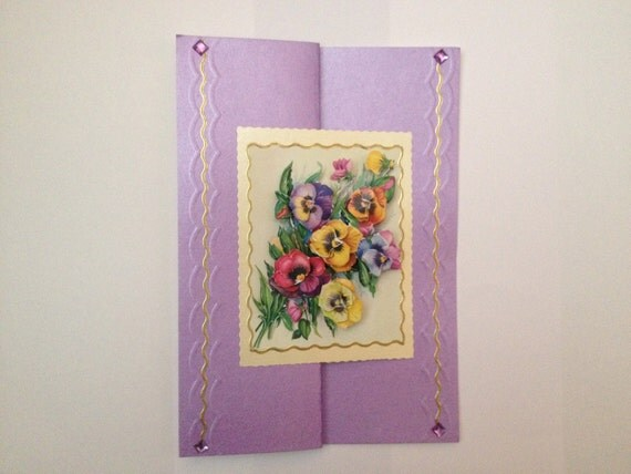 unique designed handmade greeting birthday card.Embossed Purple and gold with decoupage pansy flowers and purple diamond beads