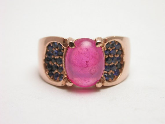 Sterling silver ring plated with gorgeous Rose Gold including a Ruby light smooth cut stone
