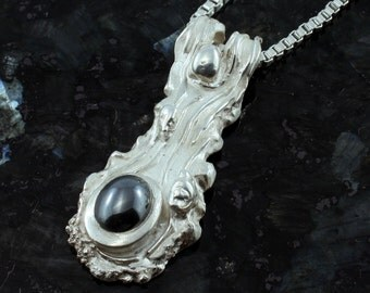 Comet Garradd fine silver pendant